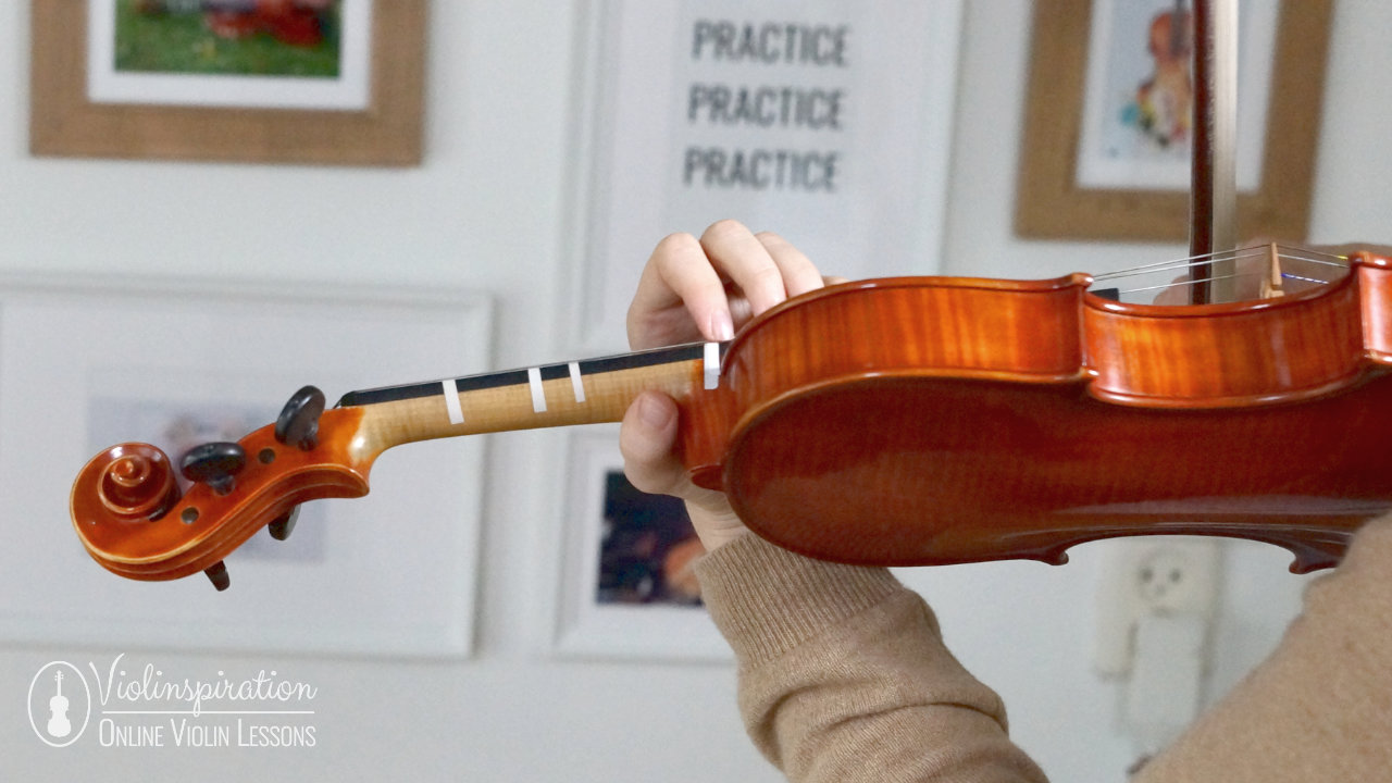 5th position on the violin - back view of the proper violin hold