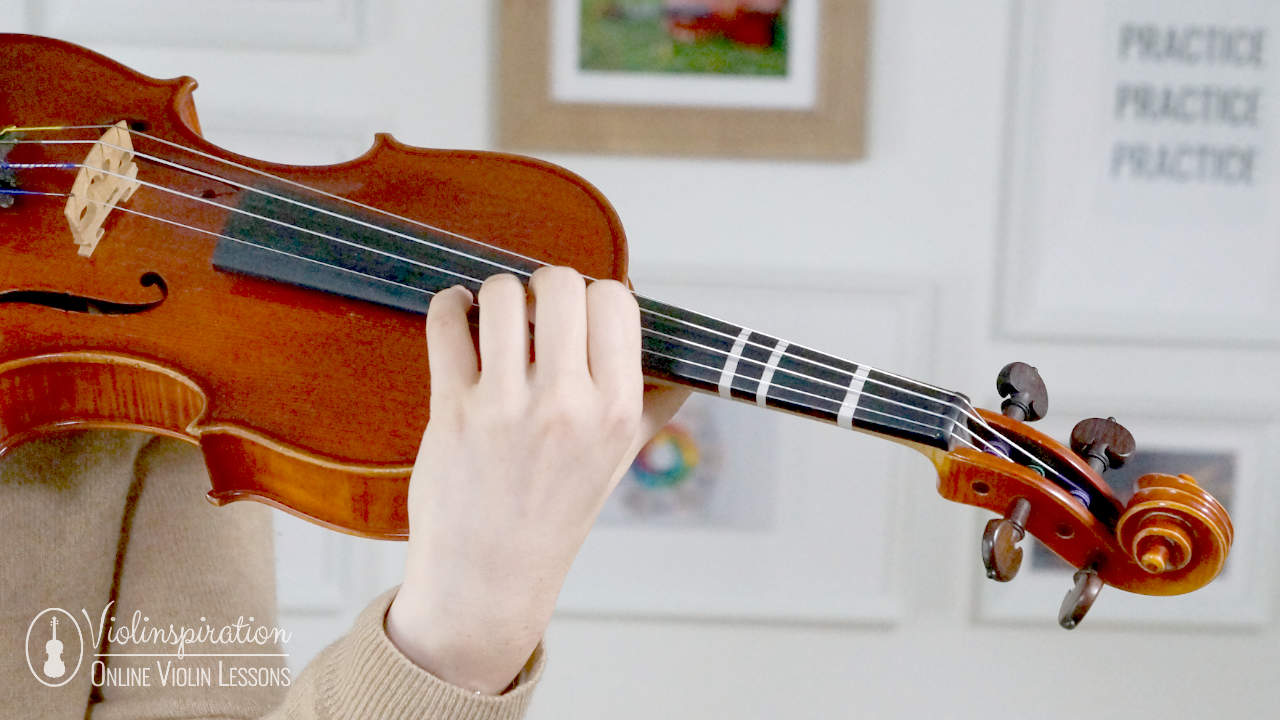 5th position on the violin - front view of the proper violin hold