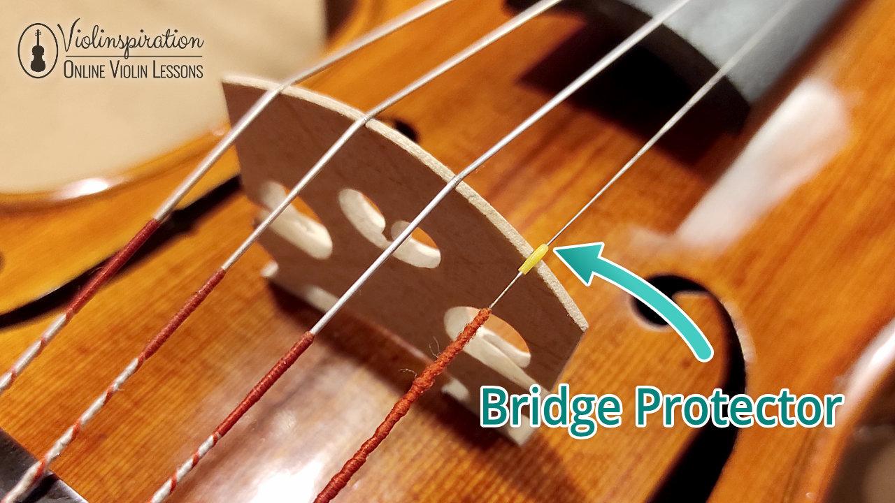 How to Change Violin Strings - Bridge Protector
