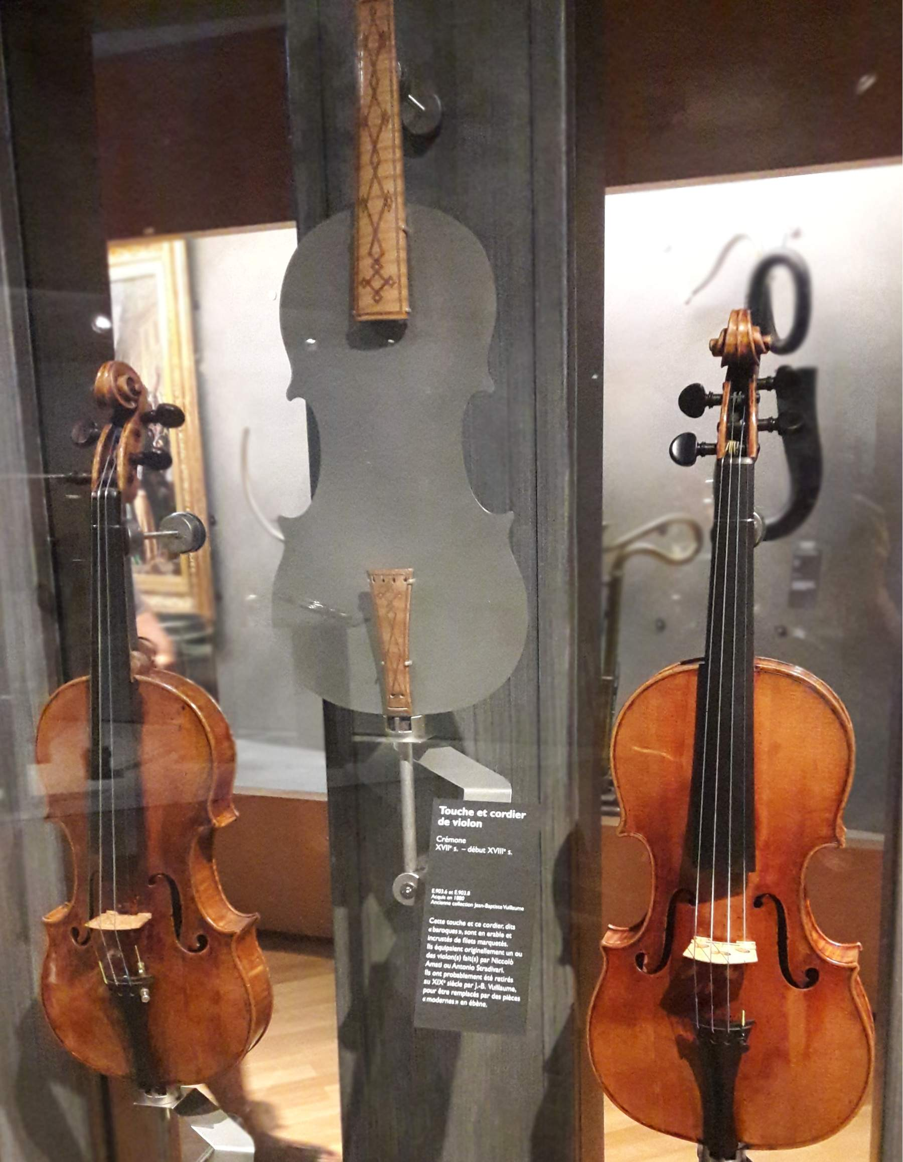 The 5 Most Expensive Violins In The World - violins made by Amati and Stradivari with an example of ornamented fingerboard and tailpiece